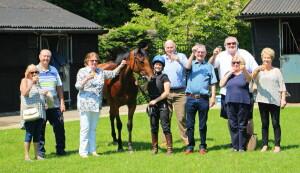Solario Racing (Childwickbury) owners toast Twilight Bay